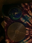 I added an earth paperweight and a labyrinth to represent travel and journey-taking.