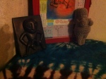 Sheela Na Gig is a protective symbol. I also have one of my crocheted Goddess of Willendorfs from my mom, since she is going to be traveling also (and the mini one went in my mini altar).