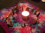 I laid out the items for my mini altar on the floor. There is stone from the woods and my woodspriestess beads as well as mini versions or representations of things from the home altar space.