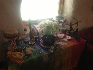 Orisha altar. A little cluttered! (there are three different areas, one for each orisha)