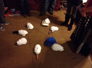 "Closing ceremony--after having created a web-weaving, we ""birthed"" our mask project into the sacred circle."