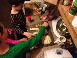 Making bread snakes.